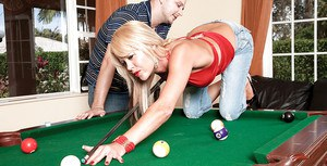 Sexy blonde in jeans Jenny Hamilton stripping and sucking on the pool table