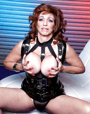 Fat mature Sheri Fox showing off in fancy latex lingerie and high heels
