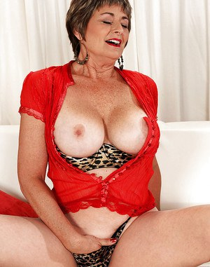 Chubby mature Victoria Peale posing upskirt and spreading her pussy