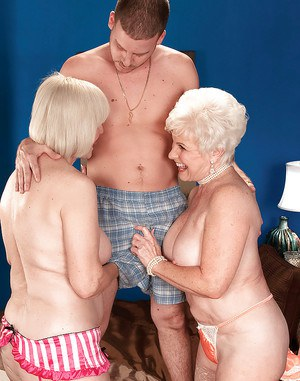 Two lustful grannies in lingerie get busy with a hard cock of a younger guy