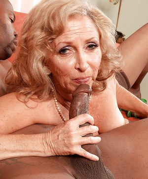 Connice McCoy in seasoned MILF lady with a strong fetish for huge black cocks and sexy lingerie and stockings.