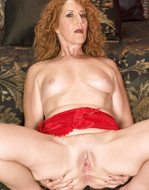 Redheaded mom Demi La Rue fingering her ass and spreading shaved pussy