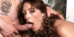 Bigtitted mature Lucy Holland gets on a huge bulging cock for hardcore banging