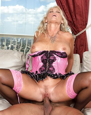 Luscious mature in stockings and corset Charley Rose seduced by a cable guy