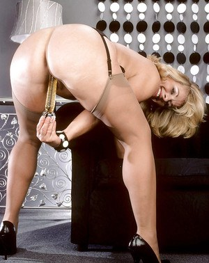 BBW mature in stockings and high heels gets naked to put a toy in her wet pussy
