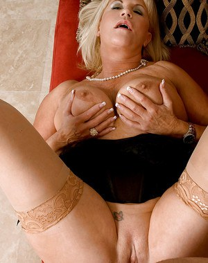 Busty mom in stockings and corset Anneke Nordstrum pleasing a cock with her pussy
