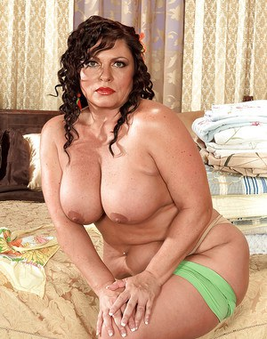 Plump mom with big boobs and booty stripping naked and showing her curves