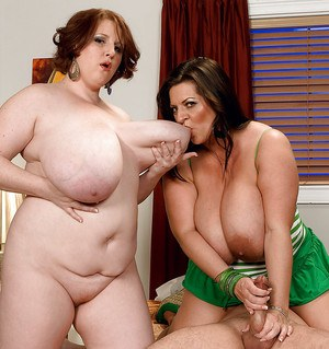 Two plump and busty ladies pleasing a hard cock by sucking and fondling it