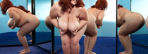 Redhead fatty Jade Parker stripping and stuffing her snatch with a huge toy