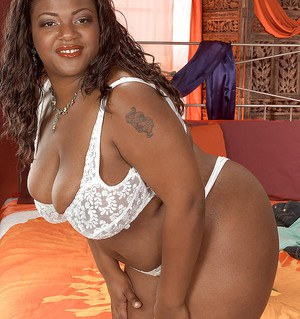 Fat black beauty Kayla Maze stripping from white lingerie to show huge tits
