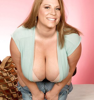Chubby blond Renee Ross demonstrating fat tits and big ass in tight jeans