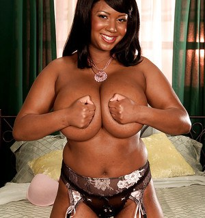 Fat black woman in contrasting lingerie and stockings undressing slowly