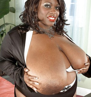 Fat black woman with big tits Simone Fox masturbating and spreading her hot pussy