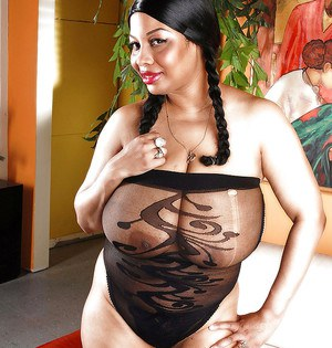 Fat girl with black pussy demonstrating her big juggs through sheer lingerie