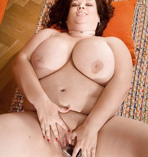 Brunette fatty with big tits spreading and stuffing her snatch with a toy