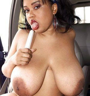 Ebony plumper from ghetto Sunny Dee denudes her massive knockers outdoor