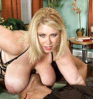 Blond bbw gets her massive boobs drenched in cum after interracial fucking