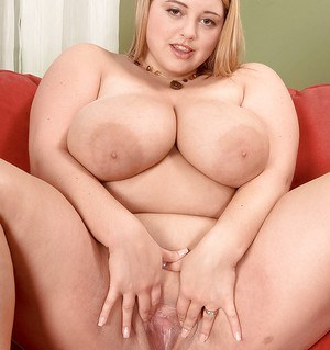 Fat blonde with humongous boobs Paige Riley spreading and stuffing her hot twat