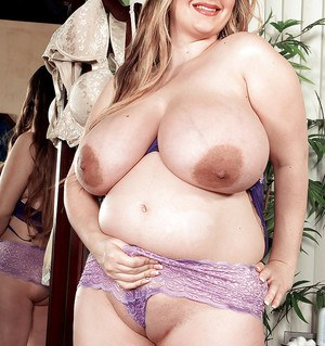 Fat pregnant beauty with huge breasts April McKenzie oiling up her shaved cunt