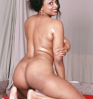 Delightsome ebony fatty foaming and rubbing her juicy melons and black pussy