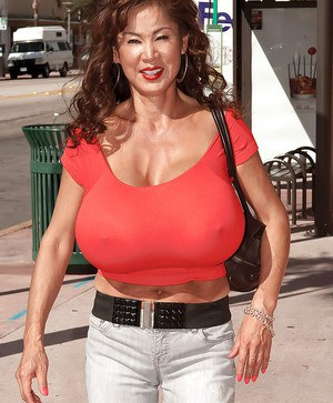 Bigtitted asian mature takes her enormous boobs for a walk around the city