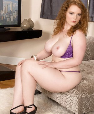Busty redhead Contessa Rose denudes fat tits and ass from purple underwear
