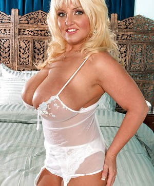 Busty bbw in sheer lingerie and stockings Stephanie Stalls goes horny in the bed