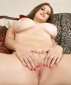 Brunette busty babe spread action with big toys and naughty fingers.