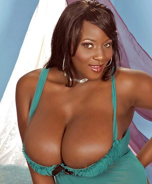 Ebony fatty chick shows off her big tits in lingerie.