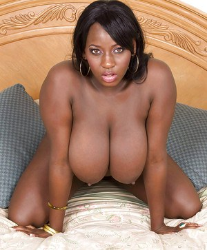 Fatty ebony babe plays with her ass and juicy big tits.