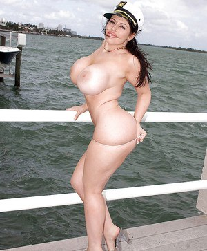 Daphne Rosen shows her big tits and fatty ass in the outdoor.
