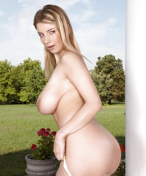 Busty chick Katarina Dubrova brings her toys to the garden.
