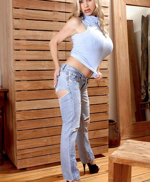 Smoking hot blonde diva in high heels and tight jeans.