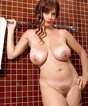 Horny MILF Busty Tina showing big tits and hairy pussy in the shower