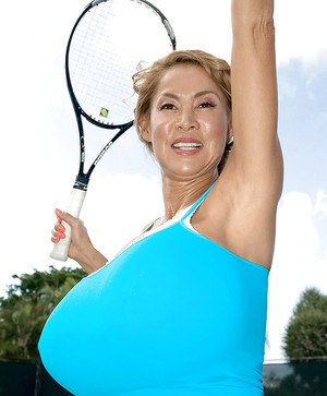 Asian MILF with huge tits plays some tennis in short skirt.