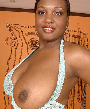 Black BBW gets naked and shows her fat tits and ass.