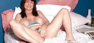 Fat mature amateur slowly undresses and has fun with herself.