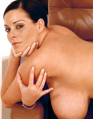 Linsey Dawn McKenzie uncovers big boobs and butt while smoking a cigar