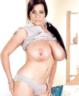 Stunning seductress Linsey Dawn McKenzie spreading hairy pussy and fondling tits