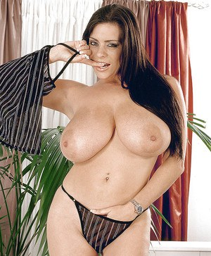 Linsey Dawn McKenzie poses in a see through lingerie that reveals her nipples.