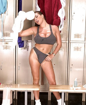 Hairy tits and big ass of Linsey Dawn McKenzie in the locker room.