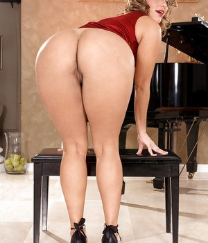 Lexy Marie and her sexy legs in heels by the piano.