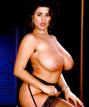 Plump seductress in black gartered stockings and heels Chloe Vevrier goes topless