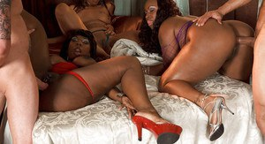 Horny black girls showing off their hot butts and sharing one bulging dick