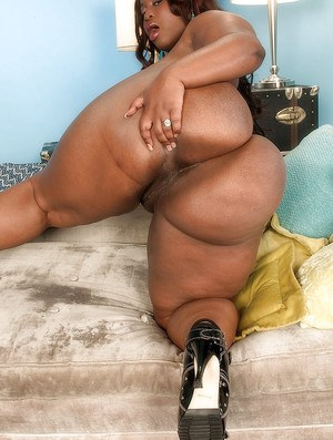Horny bbw girl showing off extremely big black ass and sucking toys
