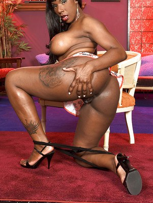 Sexy black babe Kelly Starr showing off pink and sexy tattoos on her fat ass