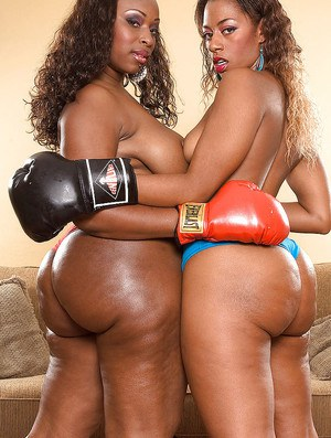 Hot ebony girls in heels and boxing gloves exposing shapely butts and fucking