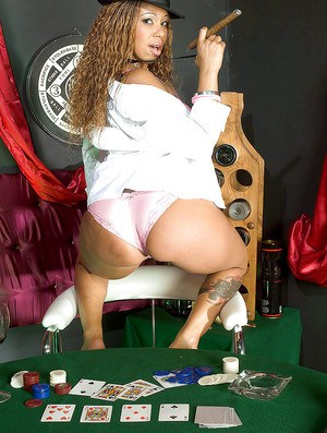 Cream Devoe getting on the poker table to show off her nice black booty