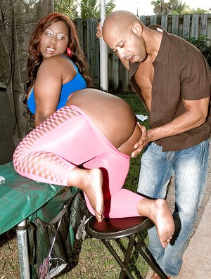 Black bbw Mz Booty brings out her fat ass from pink leggings and mounting a cock