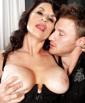 Busty mom in stockings pleasing a huge dong with her throat and shaved pussy